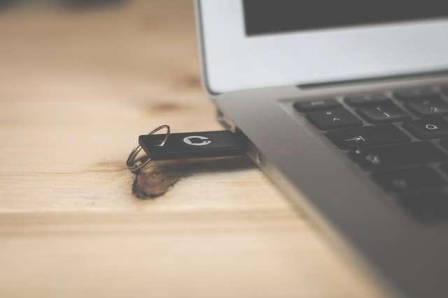 black usb drive in laptop